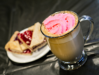 BPS® Bakery Raspberry Linzertörte Bar and a latte with cherry flavored pink whipped cream